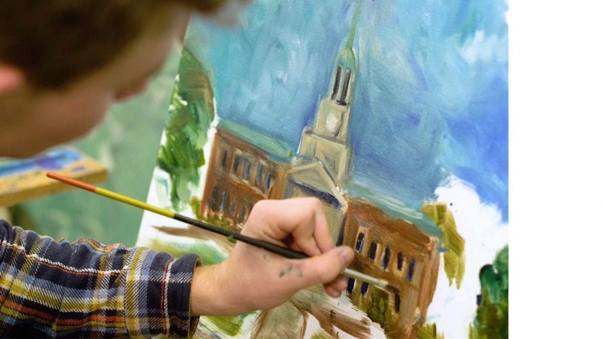 Student painting a picture