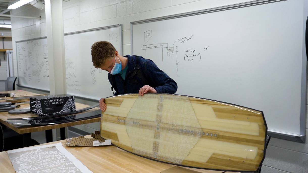 A student works on a wakeboard in an engineering lab