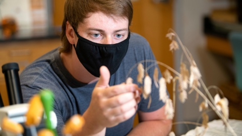 Portrait of student Jon Hayes in Herbarium