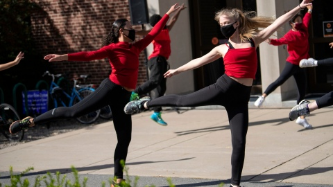 Students dance outside of the Elaine Langone Center
