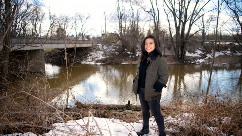 Lam Ngo '22 stands by a tributary of the Susquehanna River in Lewisburg in winter