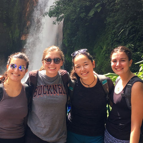 Students near waterfall in Costa Rica