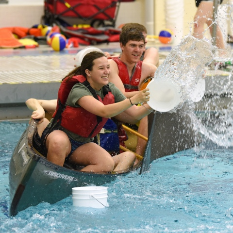 Students in the pool playing canoe battleship