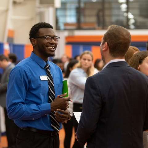 Student speaking to employer at the Employer Expo