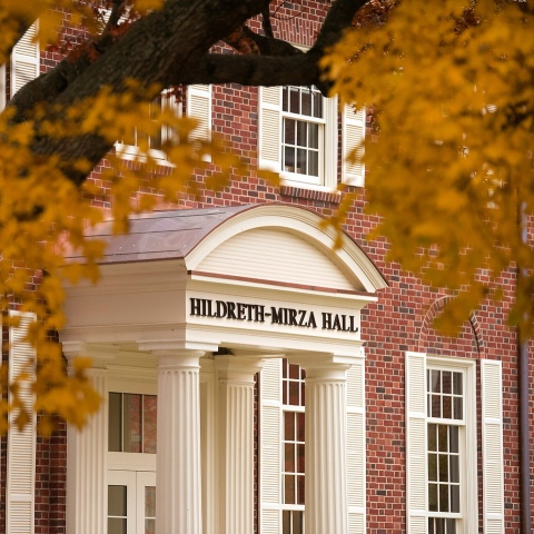 A fall picture of Hildreth-Mirza Hall's entrance