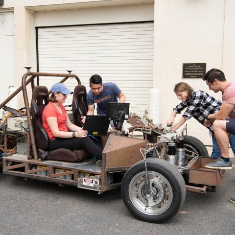 Mechanical engineering students work on car