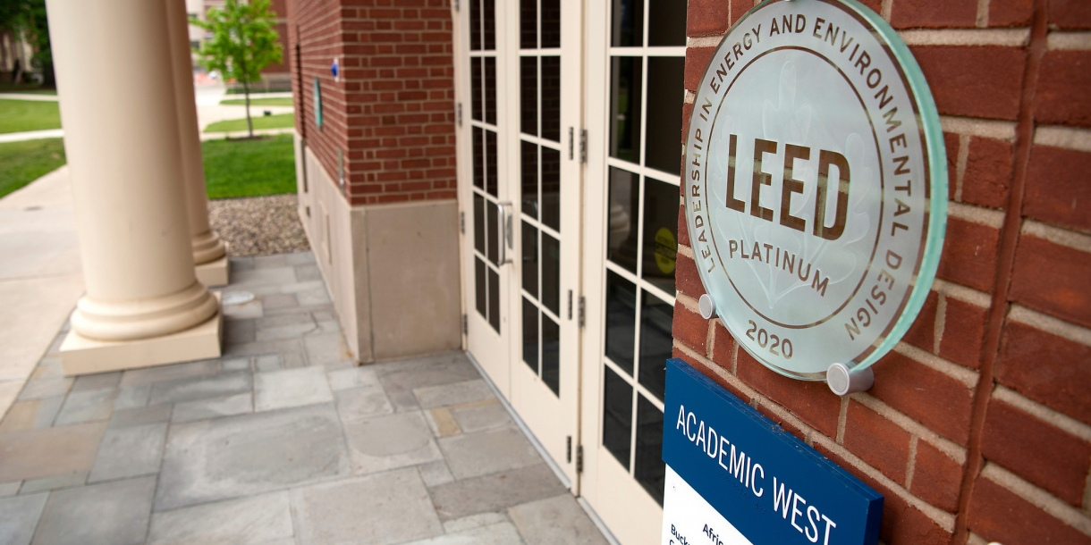 A plaque near the doorway into Academic West that reads LEED Platinum 2020