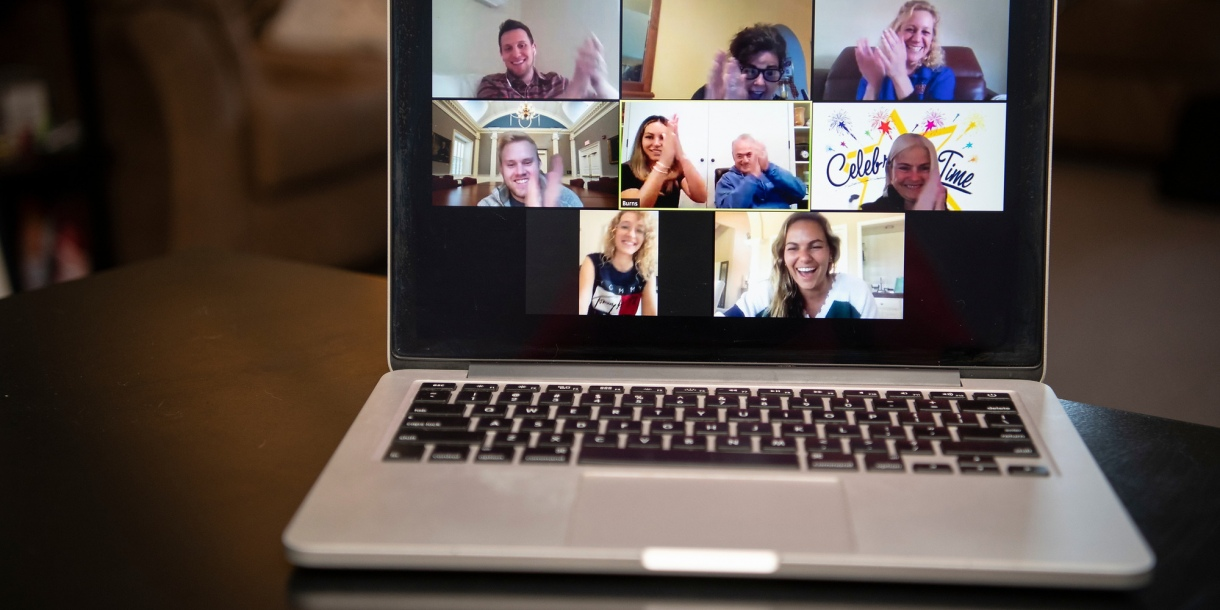 Student on a Zoom call with faculty and staff