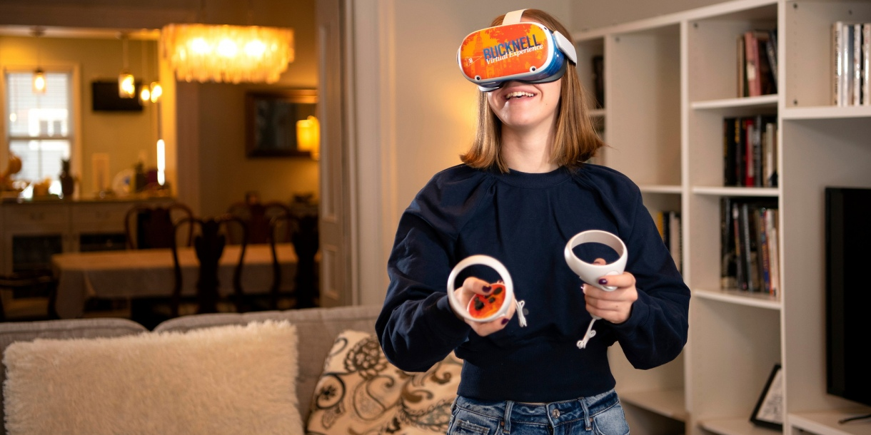 Prospective student viewing the Bucknell Virtual Experience on an Oculus