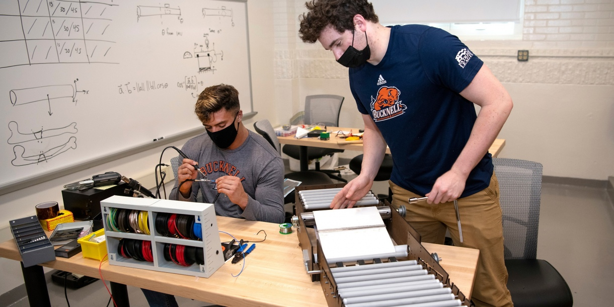 Mechanical engineering majors Michael Bortolot '21 and Nate Romanowski '21 assemble their prototype sanitizing device