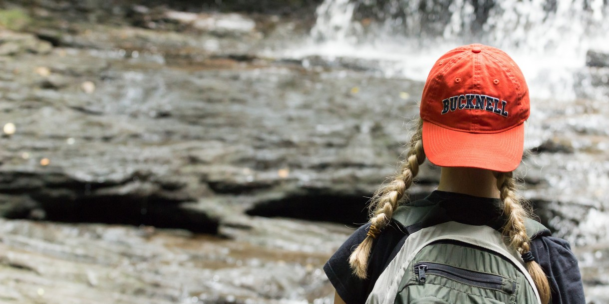 Student in front of a waterfall at Ricketts Glen
