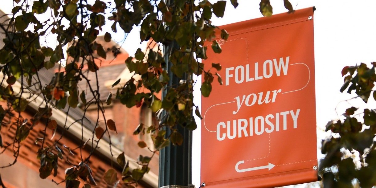 Follow Your Curiosity banner on campus