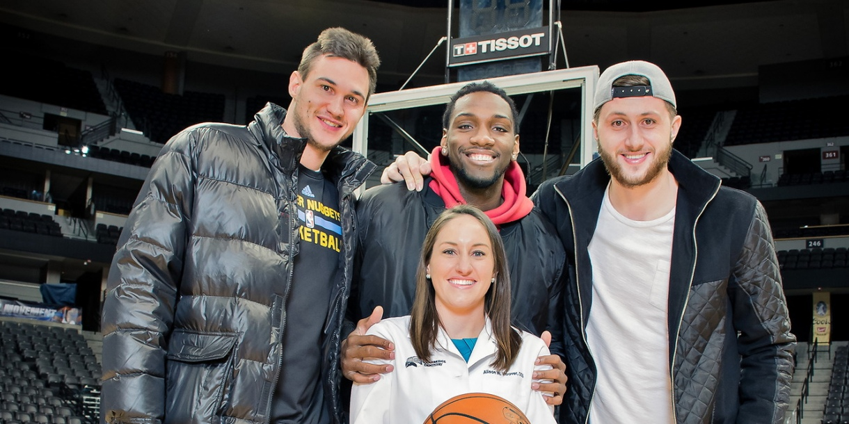 Alison Hoover with Denver Nuggets players
