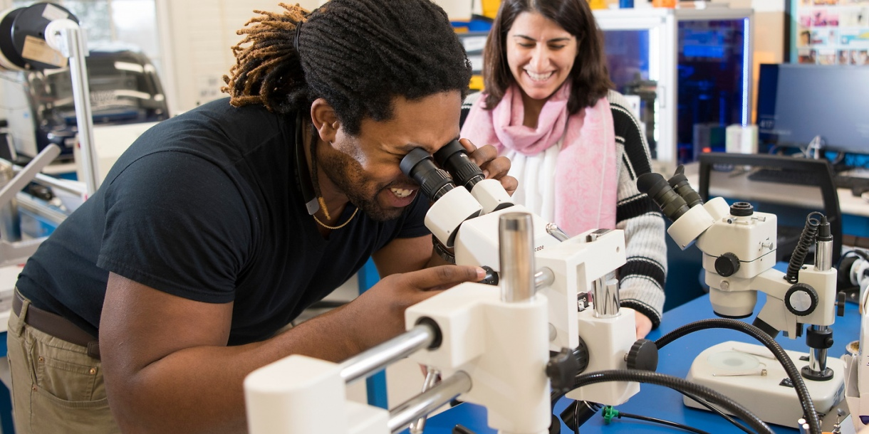 Student looks into a microscope
