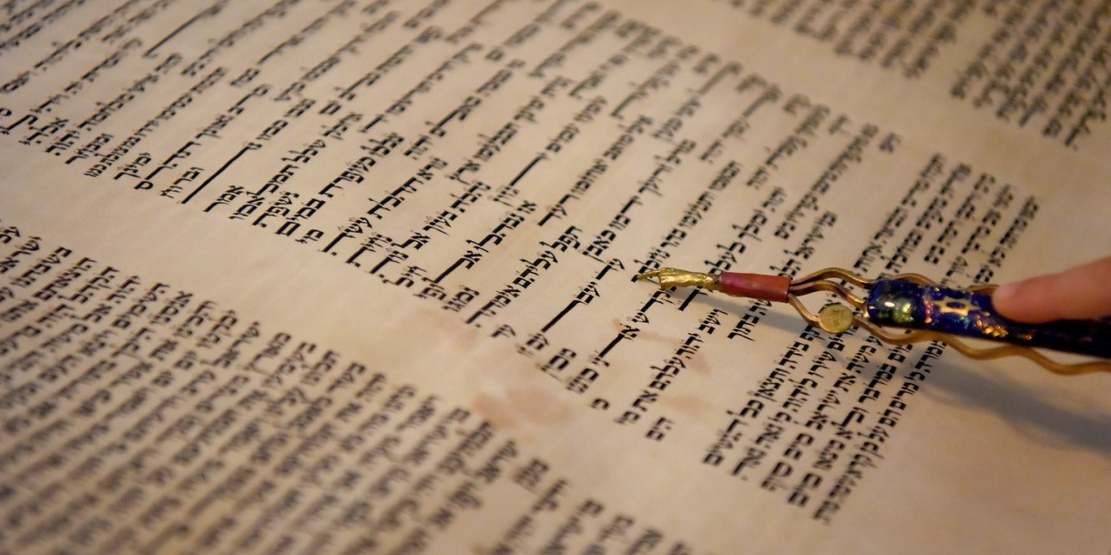 A close up of the Torah being read