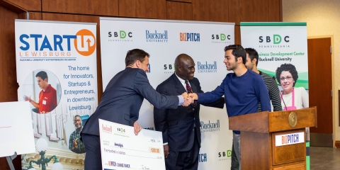 A BitPitch winner getting their check