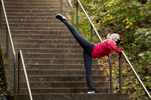 A student dances on the stairs outside the Gateway Residence Center