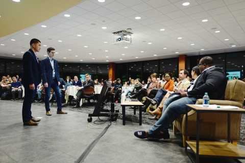 Two student pitch their ideas to a panel of judges at BizPitch