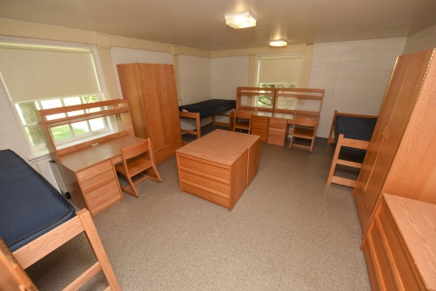 A three bed, vacant dorm room