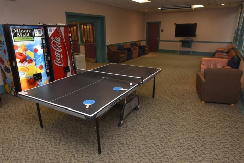 Recreation room in residence hall with ping pong table
