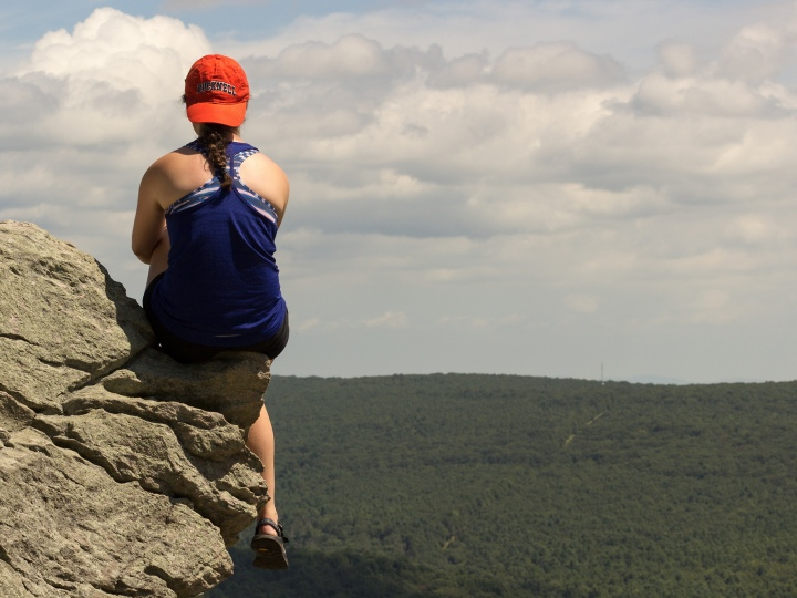 Bucknell student on rocky overhang