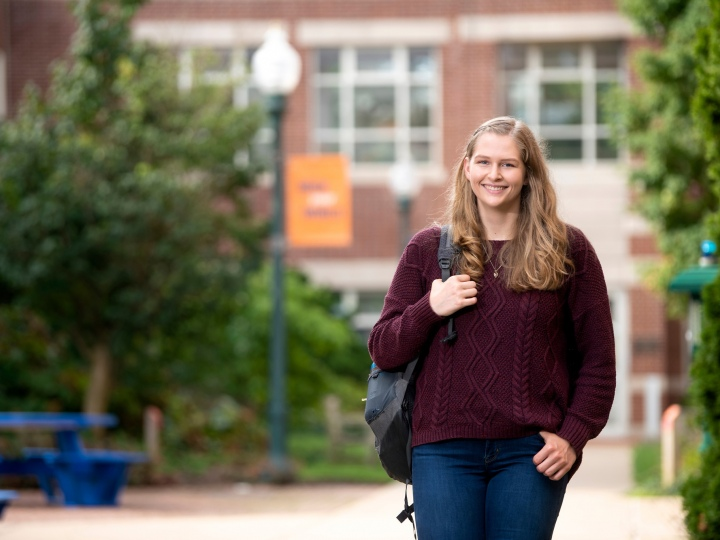 Emily Scholfield walks on campus