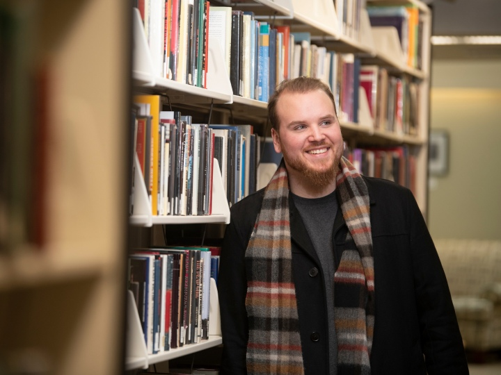 Portrait of Rich Stover '20 in library