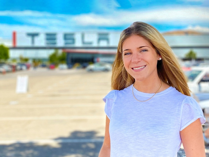 Caitlin D'Abrosio outside Tesla's Silicon Valley headquarters