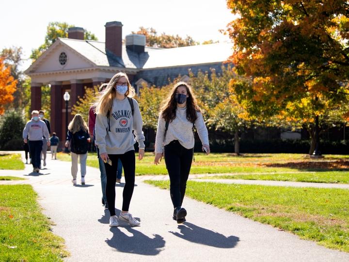 Students walk across Malesardi Quad