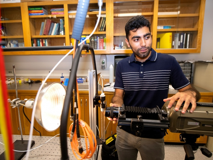 Abdullah Nabi in a mechanical engineering lab with research equipment