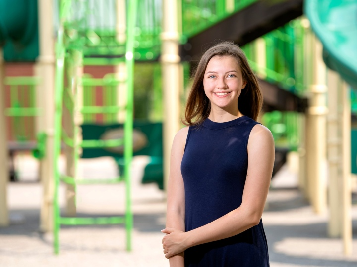 Brooke Ewer stands outside on a playground.