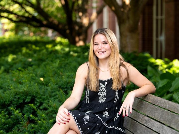 Portrait of student Hannah Sieg sitting on a bench