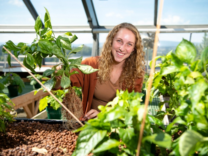 Lucille Ketterer '23 in Rooke greenhouse