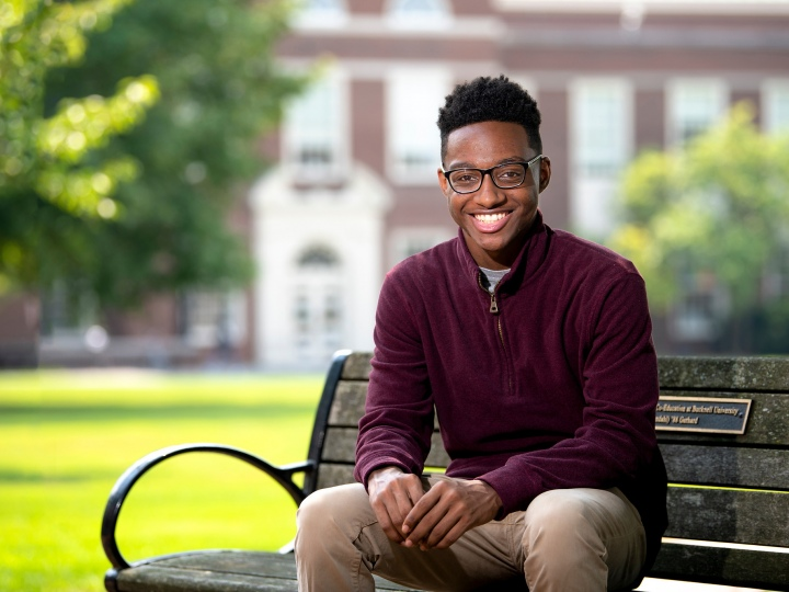 Quentin Andrews sits on a bench on Bucknell's campus.