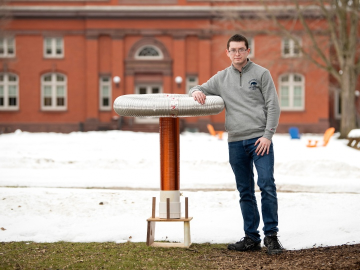 David Berry stands outside with his musical Tesla coil