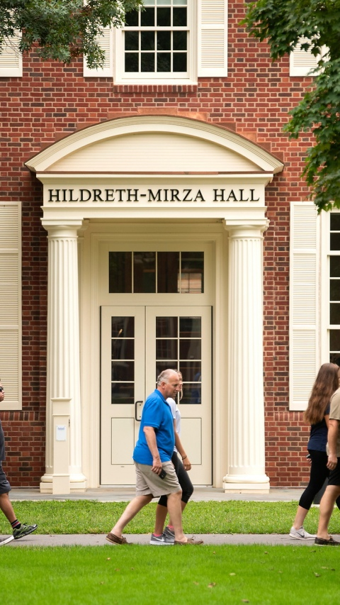 Tour walking outside of Hildreth-Mirza Hall