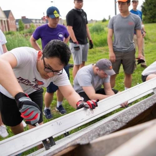 Students help install solar panels