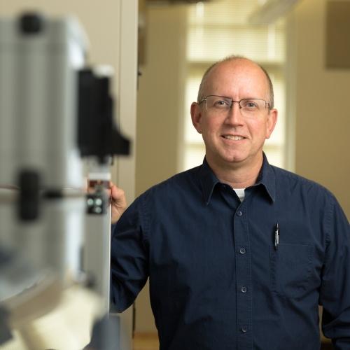 Professor standing in engineering lab